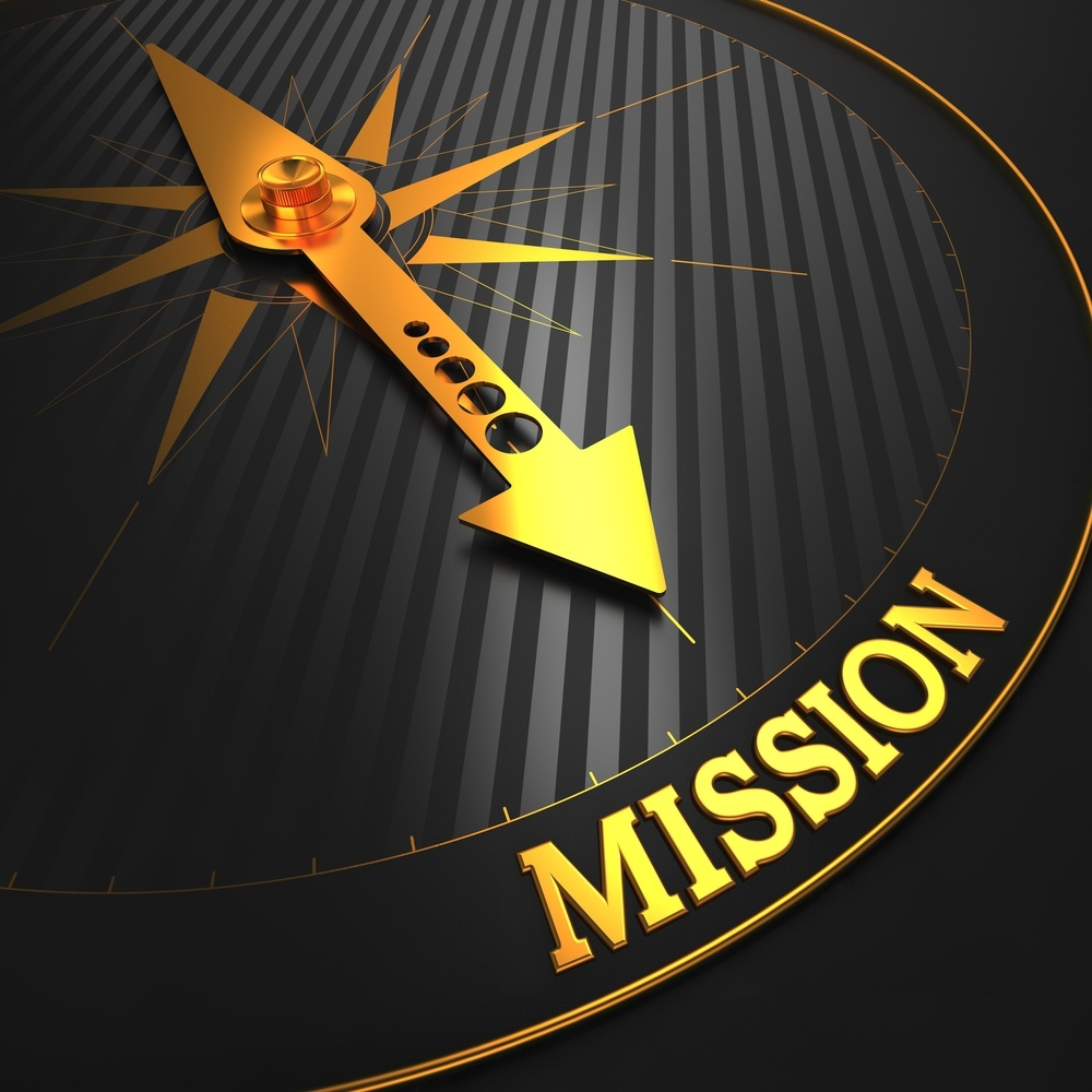 Mission - Business Concept. Golden Compass Needle on a Black Field Pointing to the Word